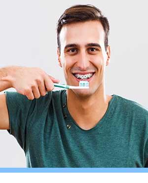 Caring for Braces interior photo man brushing San Marcos Orthodontics San Marcos CA